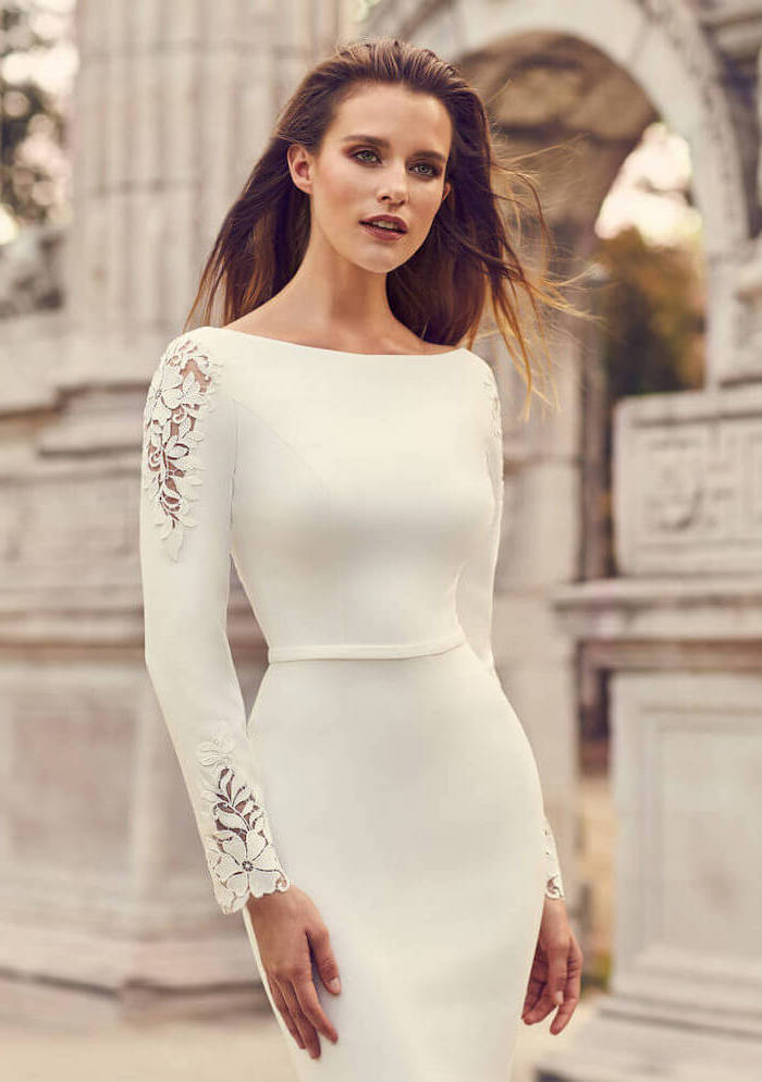 brown straight hair, long white dress, lace on the sleeves, bell sleeve wedding dress