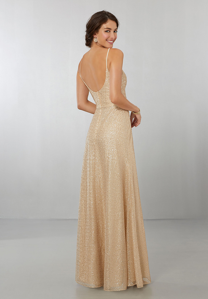 long gold dress, bare back, spaghetti straps, long sleeve bridesmaid dresses, brown hair, in a low updo