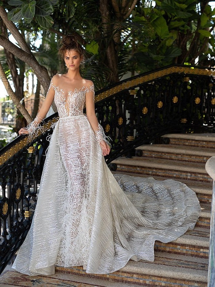 bell sleeve wedding dress, off shoulder, woman on a staircase, brown hair, in a messy bun