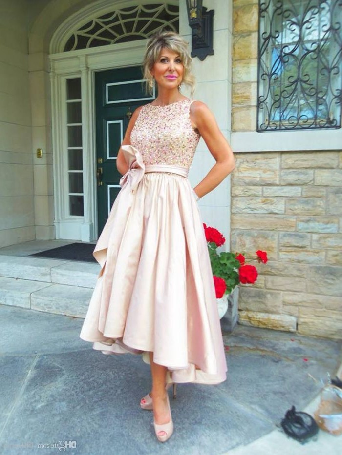 blonde hair, in a low updo, asymmetrical dress, lace mother of the bride dresses, nude open toe heels