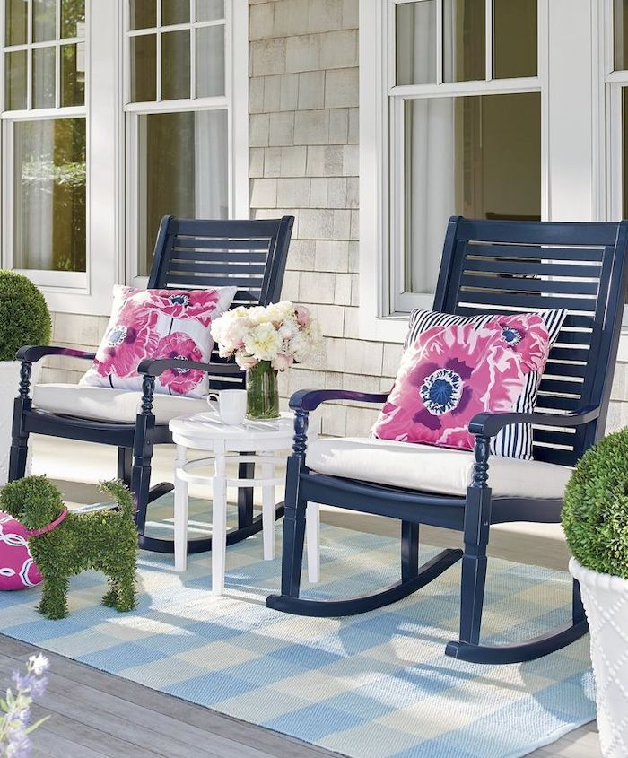 blue rocking chairs, pink and blue throw pillows, blue and white rug, screened in porch ideas, flower bouquets