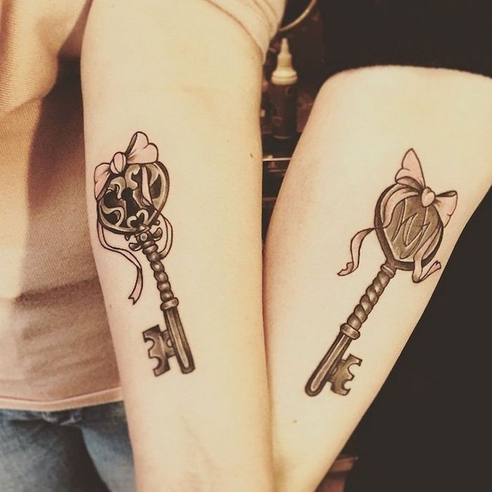 two keys, with bows, matching bestfriend tattoos, forearm tattoos, grey and black blouses