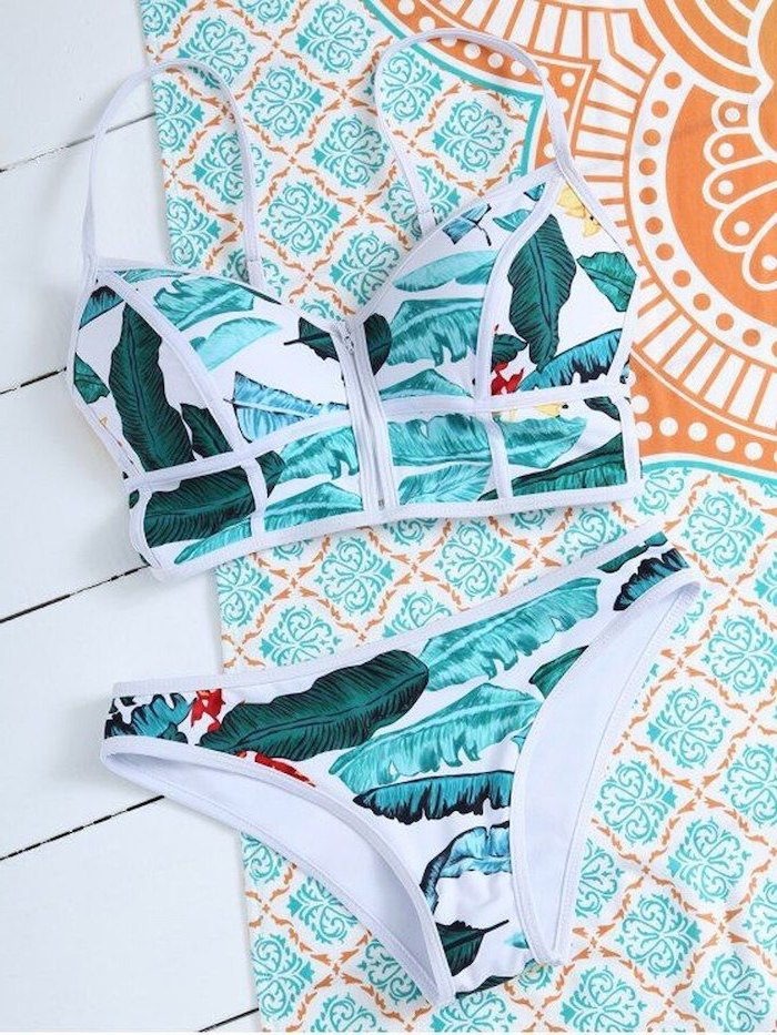 girls tankini, white with blue and green leaves print, blue and orange, beach towel, two piece