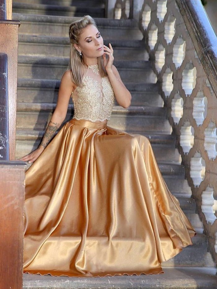 lace top, gold satin skirt, sparkly bridesmaid dresses, blonde hair, woman sitting on a staircase