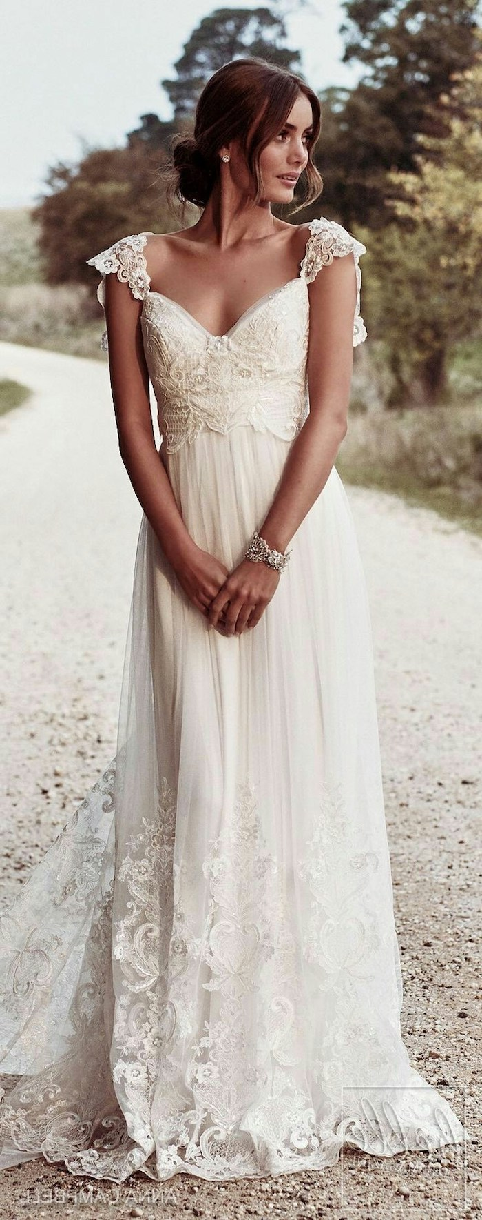 flowy wedding dress, vintage dress, made of lace and chiffon, brown hair, in a low updo