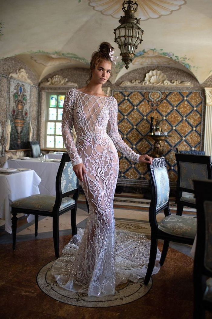 vintage restaurant, lace dress, with long train, sparkly wedding dress, brown hair, in a messy bun