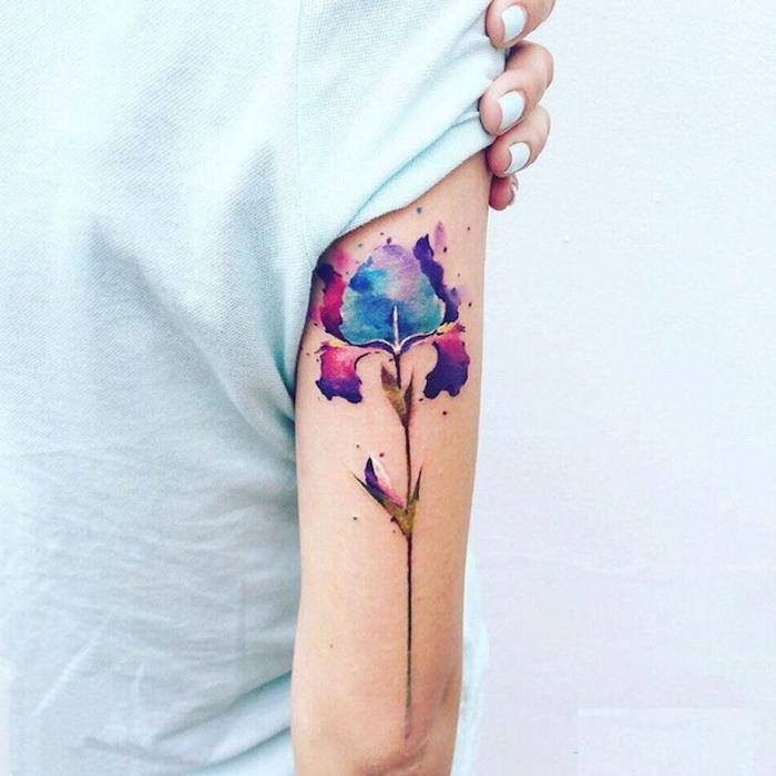 back of arm tattoo, white shirt, mens hip tattoos, watercolour flower