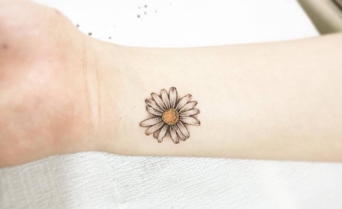 coloured daisy, wrist tattoo, small hip tattoos, white paper