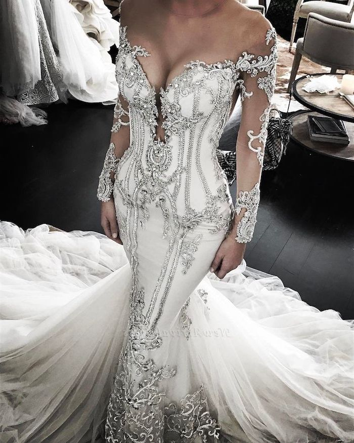 white dress, silver beads, white tulle train, black wooden floor, off shoulder, v neckline, gowns with sleeves