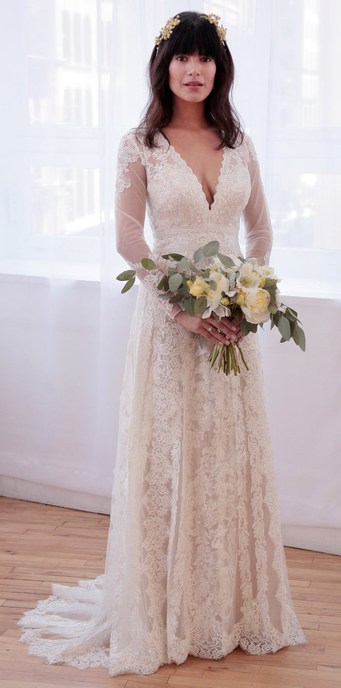 long sleeve lace mermaid wedding dress, black wavy hair, yellow and white roses, flower bouquet