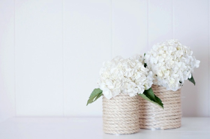 white flower bouquets, metal cans, yarn around them, diys for teens, white background
