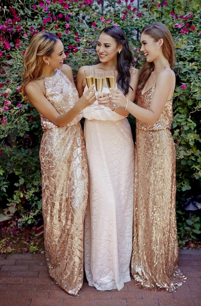 white and gold dresses, champagne flutes, sequin bridesmaid dresses, three women smiling