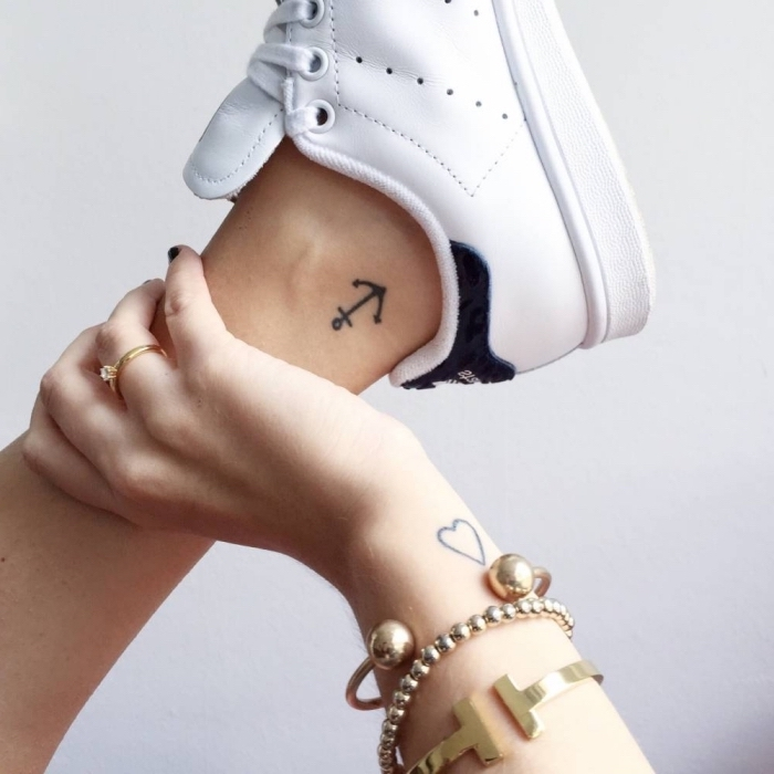 anchor ankle tattoo, heart wrist tattoo, white sneakers, gold bracelets, subtle tattoos
