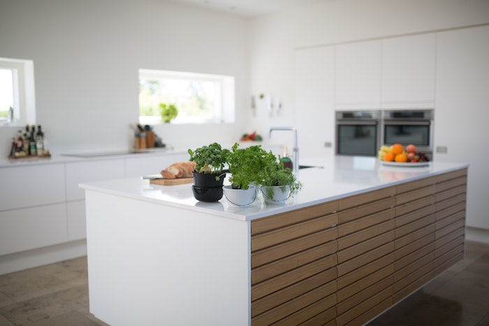 wooden kitchen island, white countertops, planted herbs, fruit bowl, remodeling a kitchen