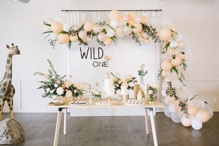 wild one, large giraffe figurine, blush and white balloons, large flower bouquets, teen birthday ideas