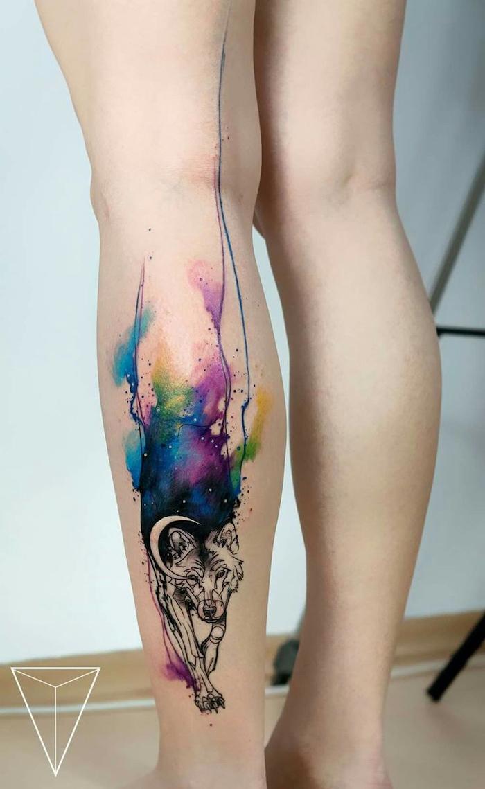 back of leg, watercolor butterfly tattoo, wolf walking