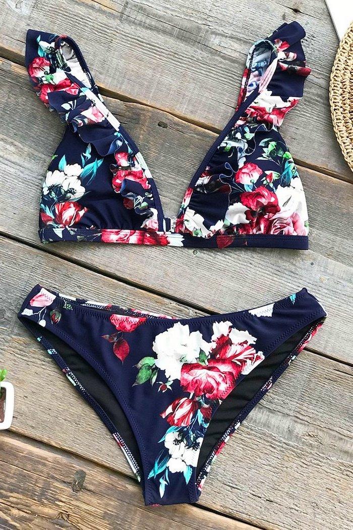 childrens swimwear, dark blue, floral print, two piece, wooden background