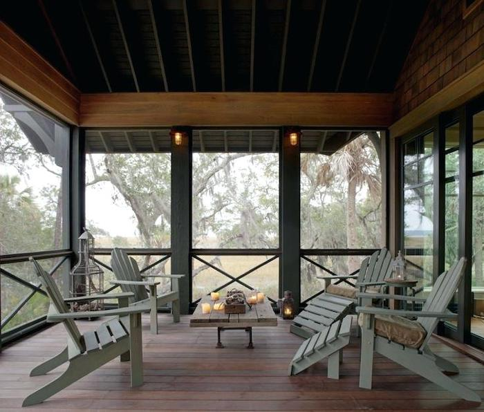 grey wooden chairs, small wooden table, screened in porch, front porch pictures, candles everywhere