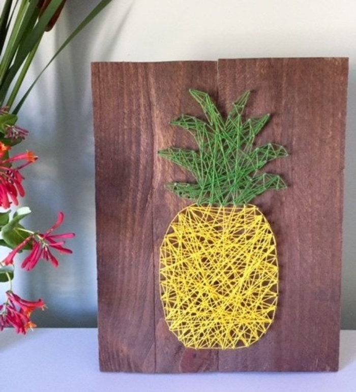 wooden background, pineapple made of yarn, things to do when bored for kids