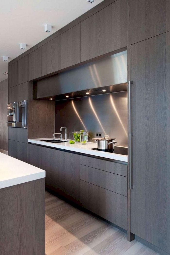wooden cabinets, built in utensils, light above the sink, kitchen remodeling, white countertops