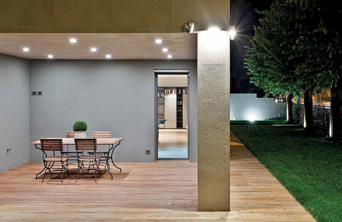 cement column, wooden floor, front porch railing ideas, wooden garden furniture, lights on the ceiling