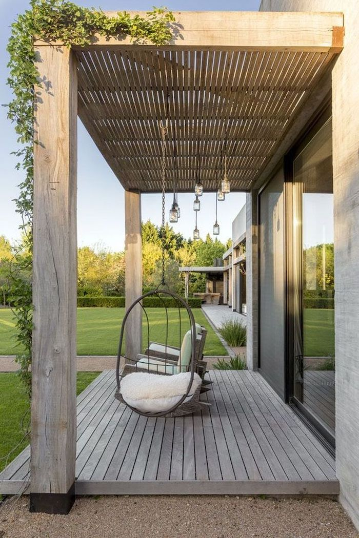 front porch furniture, wooden swing, white cushion, armchairs with blue cushion, wooden porch