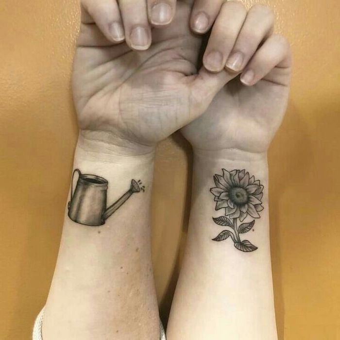 mother daughter celtic symbols, wrist tattoos, watering a sunflower, yellow background