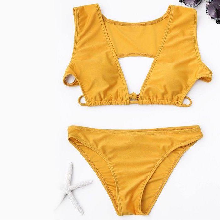 yellow two piece, white background, childrens swimwear, black sunglasses
