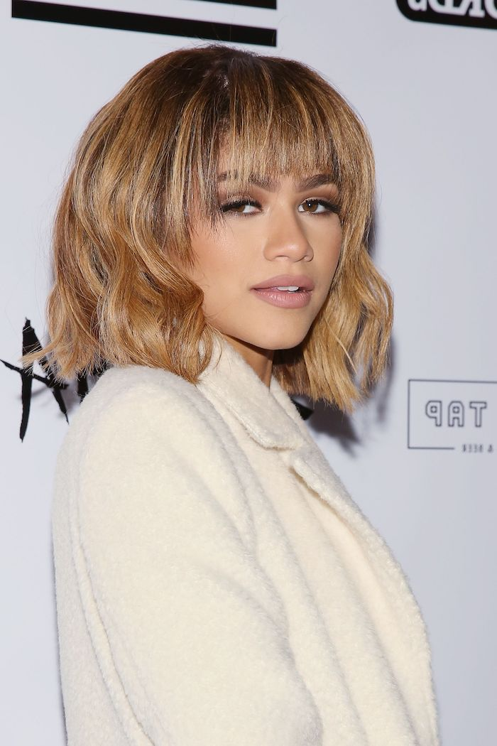 zendaya with blonde hair, with bangs, bob weave hairstyles, white jacket