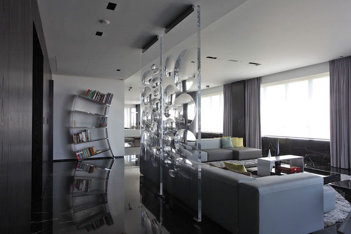 room dividers, two separate, made of glass, intricate design, large grey corner sofa, black floor