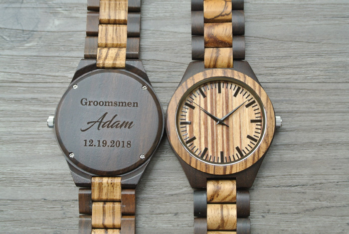 groomsmen gifts, wooden watch, personalised with name and date, on a wooden background