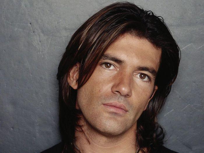 antonio banderas, looking at the camera, cool haircuts for men, black hair, grey background