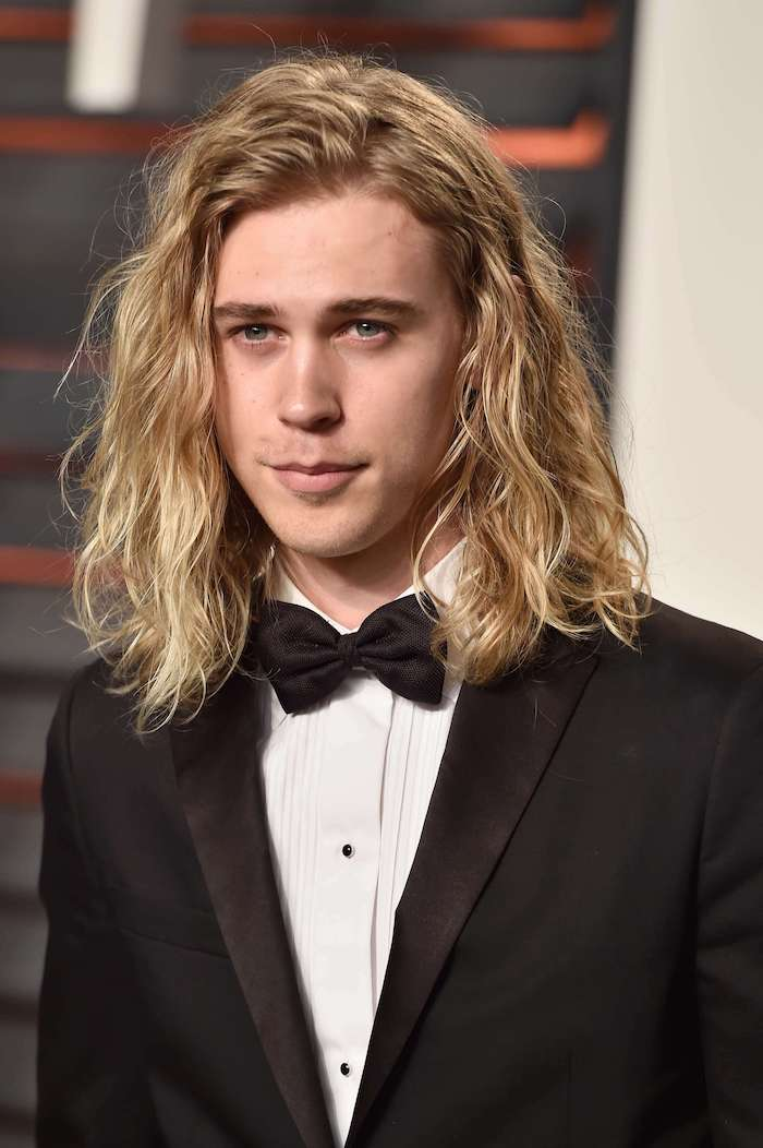 austin butler, blonde curly hair, long hairstyles for men, black tuxedo, white shirt