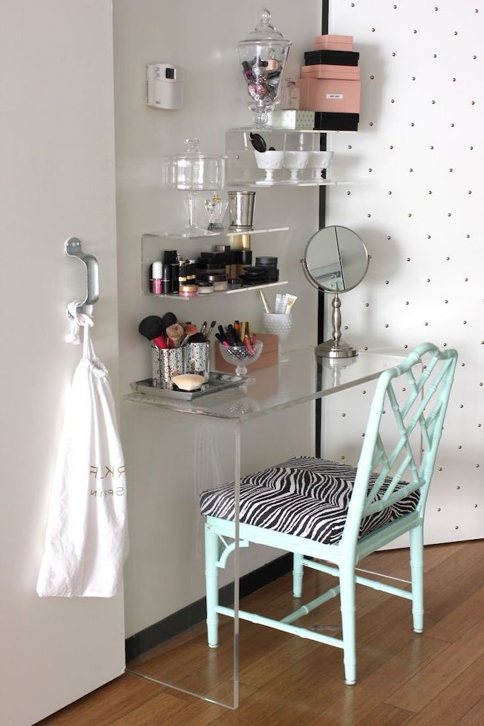 makeup vanity with lights, acrylic table and shelves, turquoise chair, zebra printed cushion