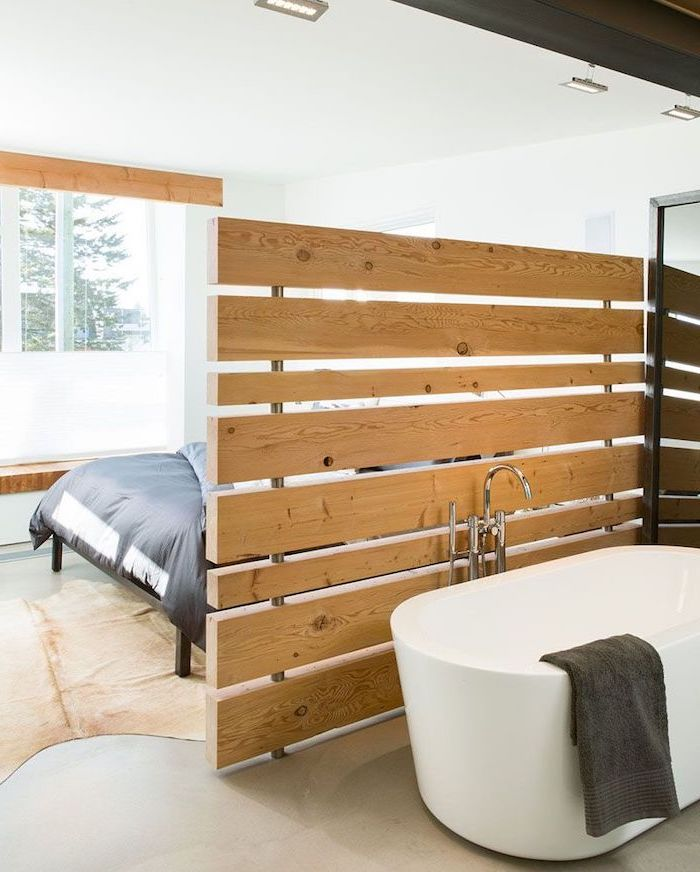 wooden blocks, screen dividers, separating bathroom and bedroom, white bathtub, white walls