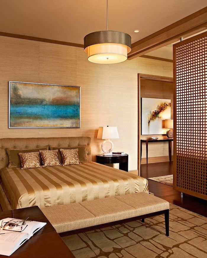 large bed, beige ottoman, wooden floor, room dividers, made of wood, abstract art, over the bed