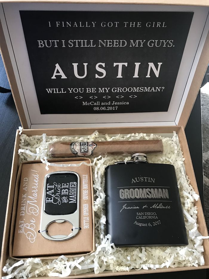 carton box, metal flask, bottle opener, wrapped cigar, groomsmen gifts