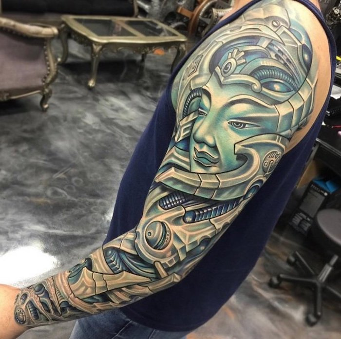 coloured biomechanical tattoo, grey floor, blue top, half sleeve tattoo