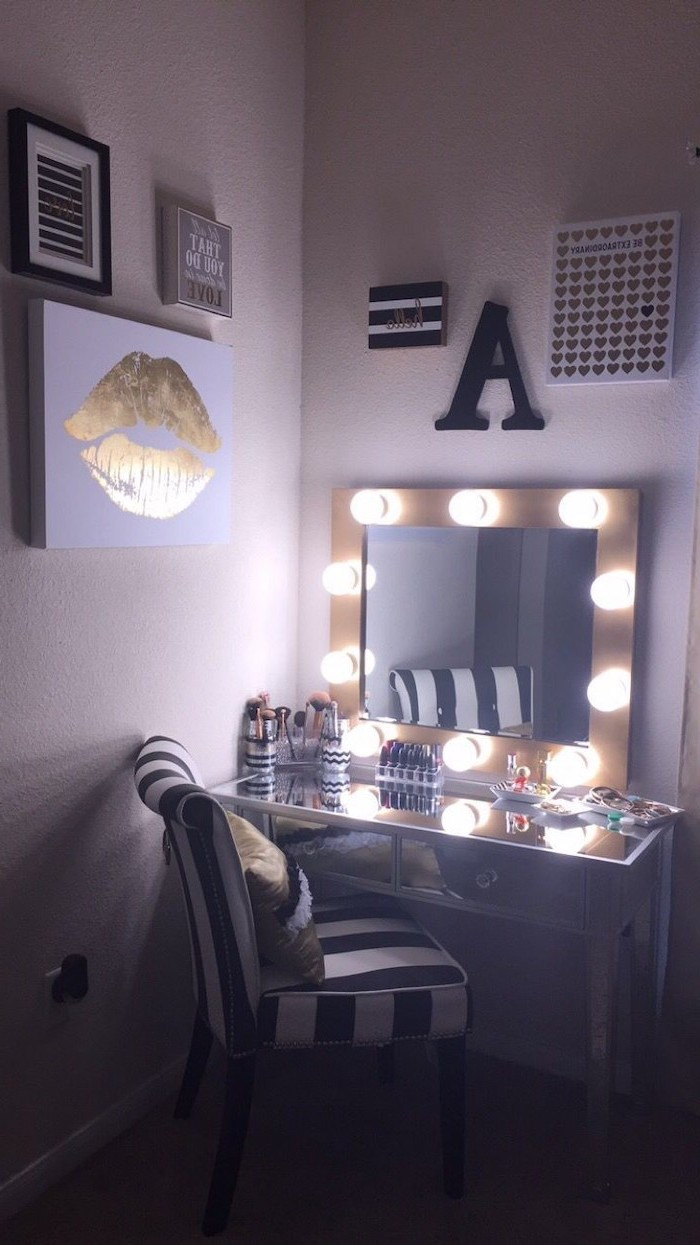 white walls, mirror with lights, diy makeup vanity, black and white striped chair, mirrored countertop
