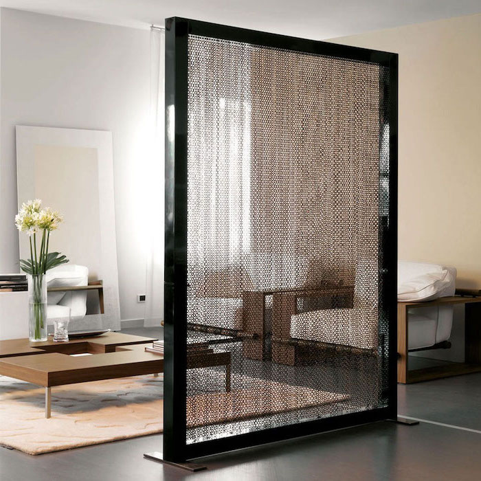 black frame, hanging chainmail, black floor, white armchairs, wooden table, white carpet, room dividers