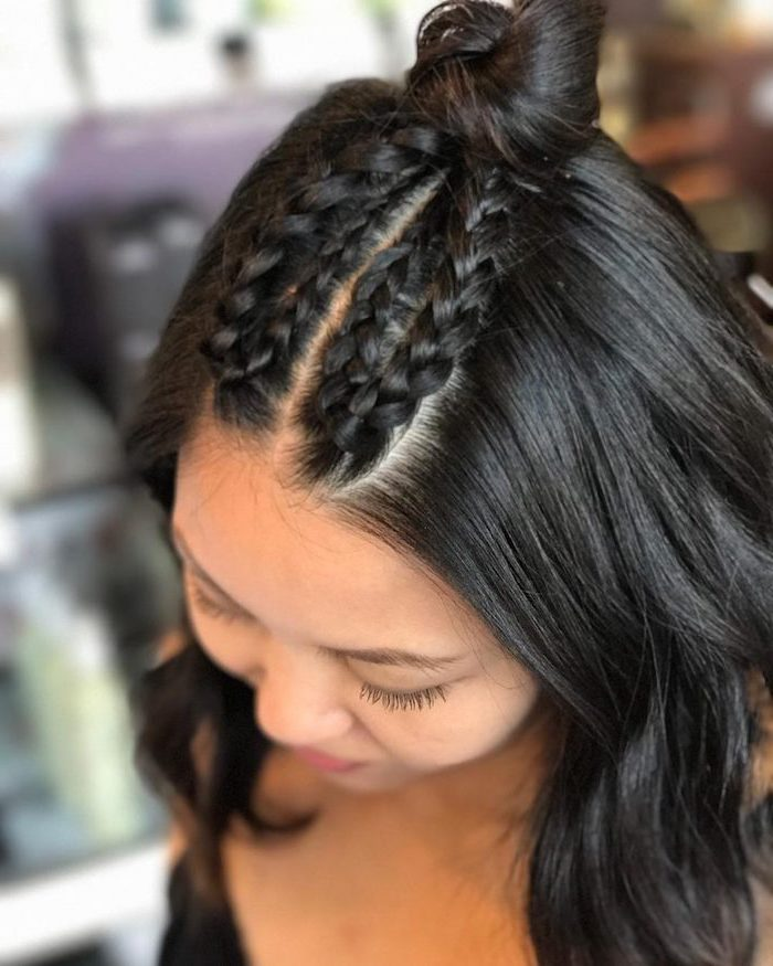 black hair, four small braids, small bun, how to do a french braid, blurred background