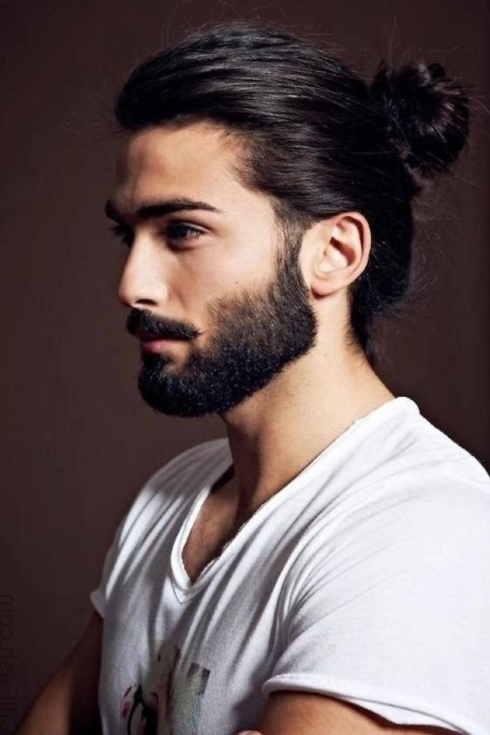 black hair and beard, man bun, cool haircuts for men, white shirt, dark background