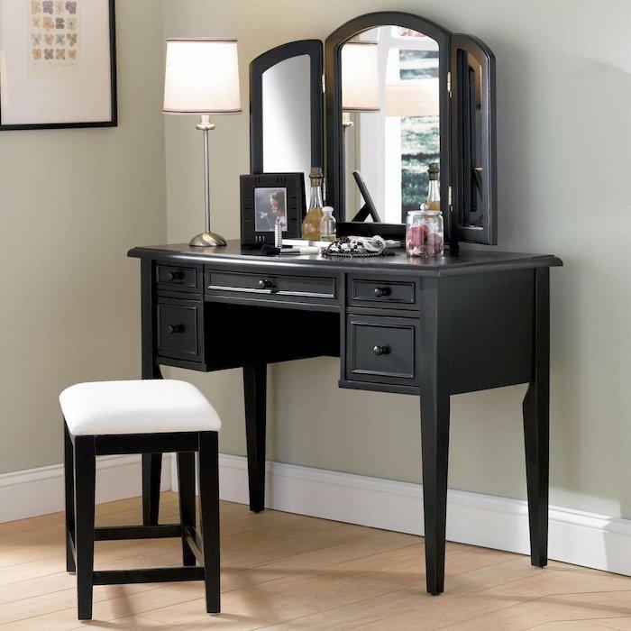 black wooden table, wooden stool, makeup vanity, three fold mirror, wooden floor