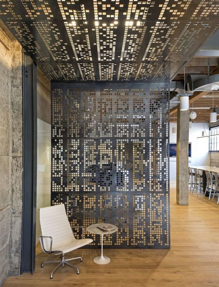 black metal panel, going up to the ceiling, room divider ideas, white chair, small round table, wooden floor