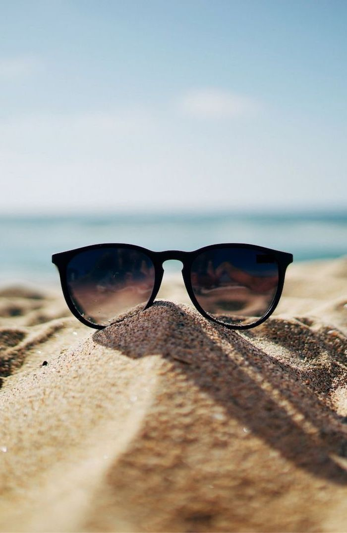 black sunglasses, in the beach sand, cute backgrounds, blue sky