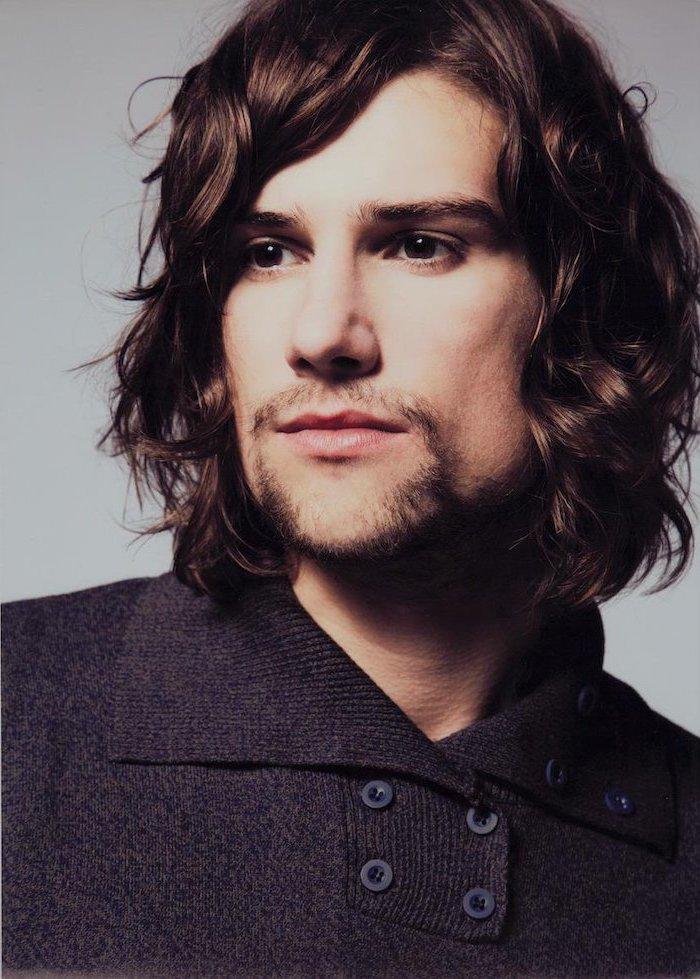 black curly hair, black sweater, hair styles for men, white background