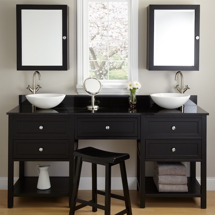 black table, two sinks, two mirrors, black metal stool, small round mirror, makeup vanity with lights