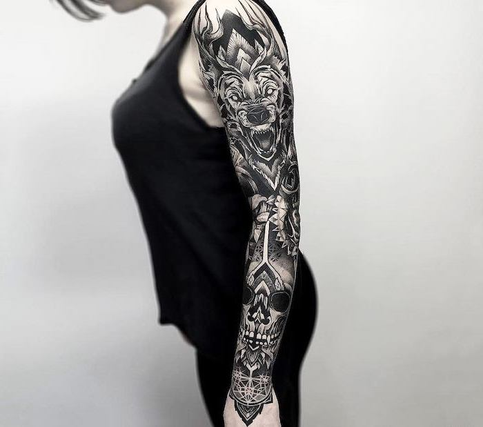 black top, black pants, white background, lion and skull, arm tattoos for women
