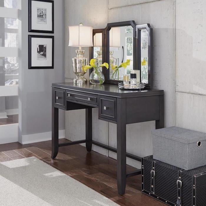 three fold mirror, black makeup vanity, wooden floor, white carpet, white walls