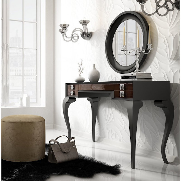 white wall, black wooden, makeup vanity, gold ottoman, black rug, round mirror
